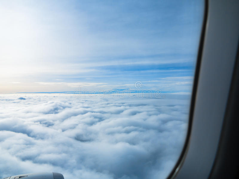 Clouds view from air plane with horizon.  royalty free stock photo