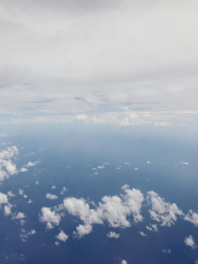 Clouds. view from the window of an airplane flying in the clouds. Right View, Plane Window View with blue sky royalty free stock image