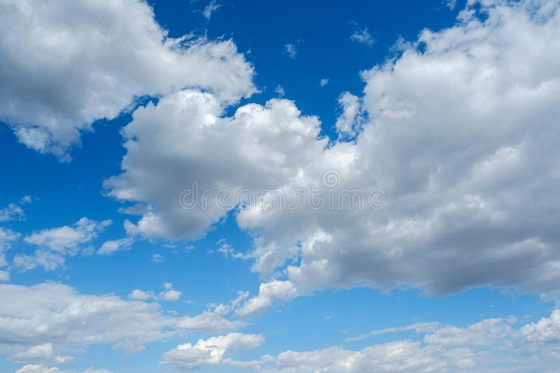 Clouds white blue sky fluffy windy weather daylight sunny stock images