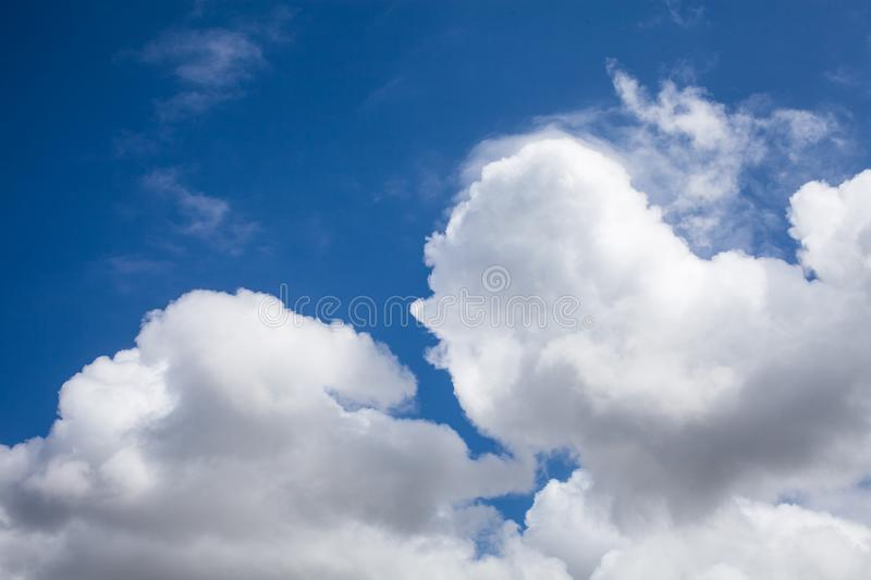 Cloudscape background. Blue sky background with white clouds. Sky after raining. Close up view of beautiful blue sky background. stock images