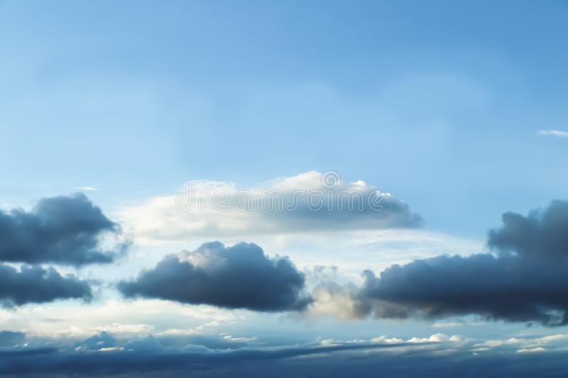 Cloudscape - Blue sky with layers of clouds near the bottom as a storm forms - no land - background or room for text royalty free stock photos