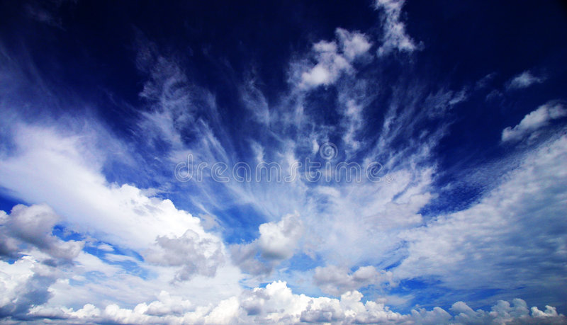 Cloudscape dramatic abstract. An image of a dramatic cloudscape in a dark blue tropical sky. Taken with a wide angle lens and circular polarizing filter for a stock photos