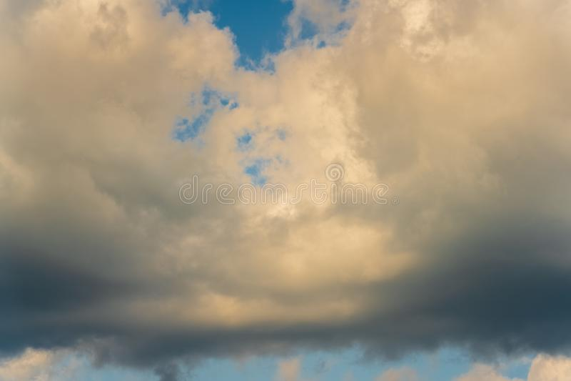 Cloudscape, dramatic clouds floating across blue sky weather change before summer rain stock images