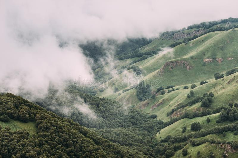Cloudscape and mist over mountain valley. Cloudscape and mist over summer mountain valley, beautiful nature background stock images