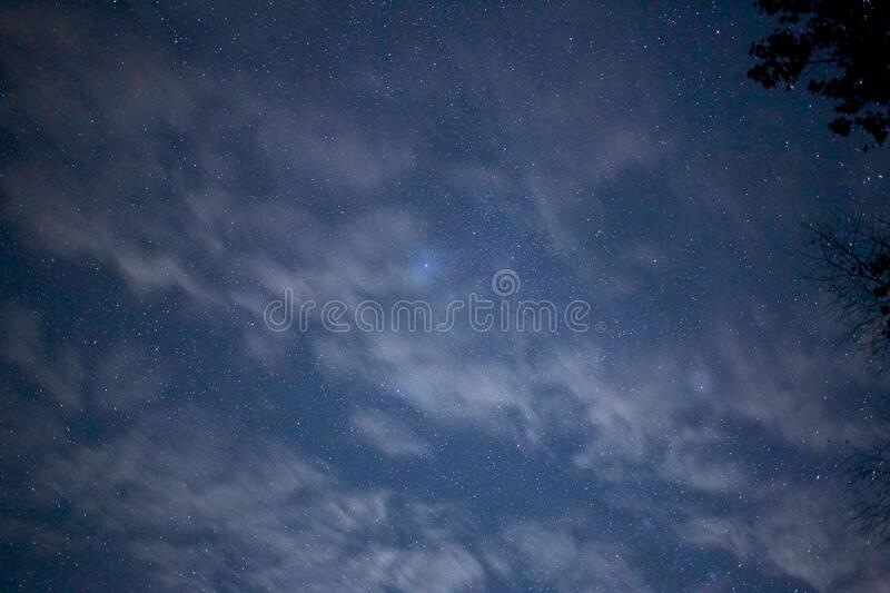 Cloudscape on starry night royalty free stock images