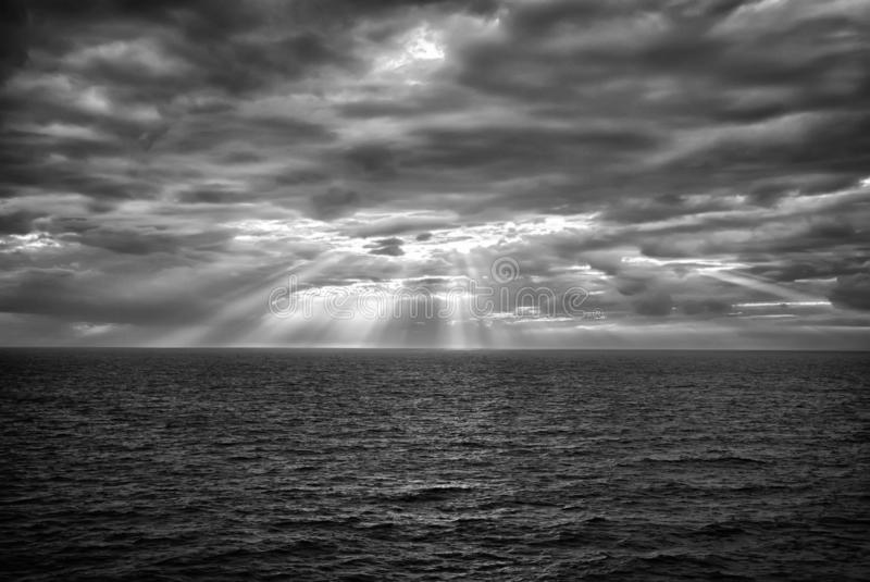 Cloudscape with sunrays over sea in London, United Kingdom. Sea on cloudy sky. Clouds on dramatic sky. Evening nature. And sunset. Freedom and wanderlust royalty free stock image