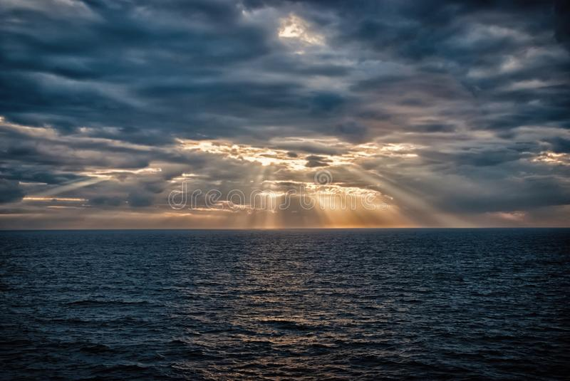 Cloudscape with sunrays over sea in London, United Kingdom. Sea on cloudy sky. Clouds on dramatic sky. Evening nature. And sunset. Freedom and wanderlust royalty free stock photography