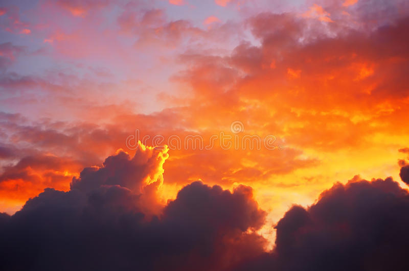 Cloudscape at sunset with red clouds. Cloudscape at sunset with dramatic red clouds royalty free stock images