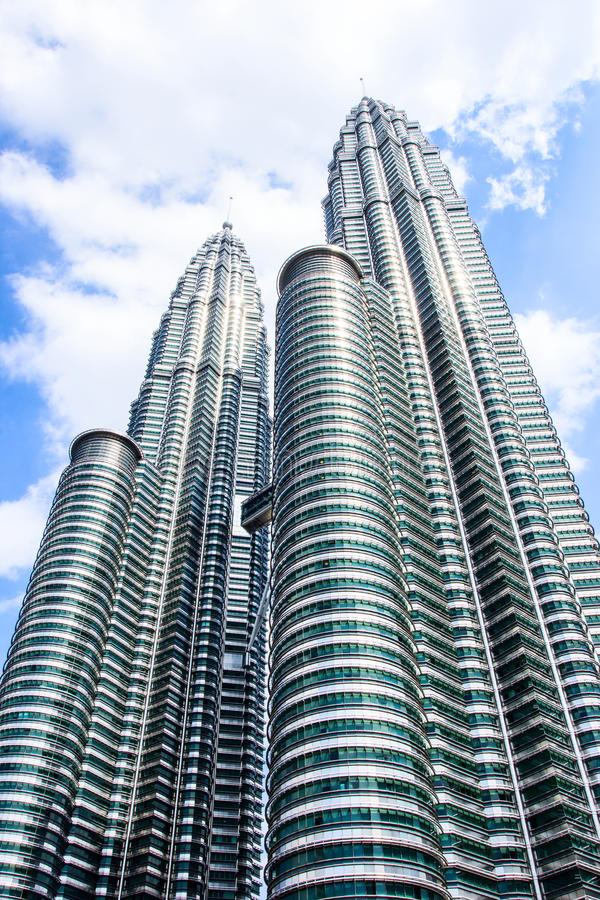 Cloudscape view of the Petronas Twin Towers at KLCC City Center. The most popular tourist destination in Malaysian capital. KUALA LUMPUR, MALAYSIA - FEB10, 2015 stock images