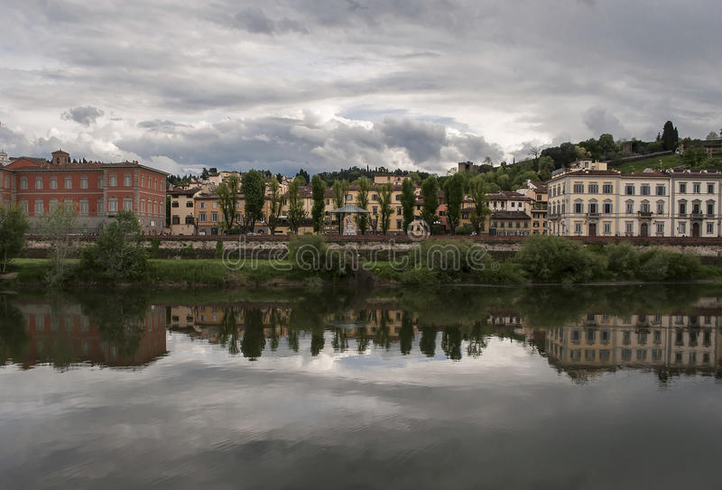 Cloudy afternoon above the river and town Florence Italy. Cloudy afternoon above the river Arno in Florence Italy. This part of town is named Lungarno and at royalty free stock photography