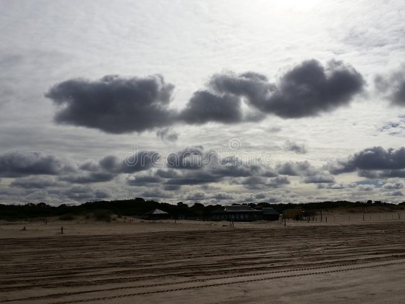 Cloudy beach royalty free stock images