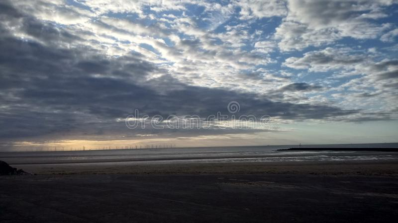 Cloudy beach royalty free stock photo