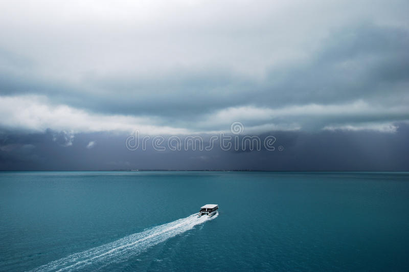 Cloudy Belize. The tender boat heading towards Belize City (Belize stock image