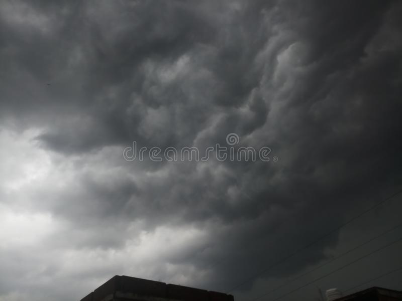 Cloudy blacky weather. Rain, horror, schenerio royalty free stock photo