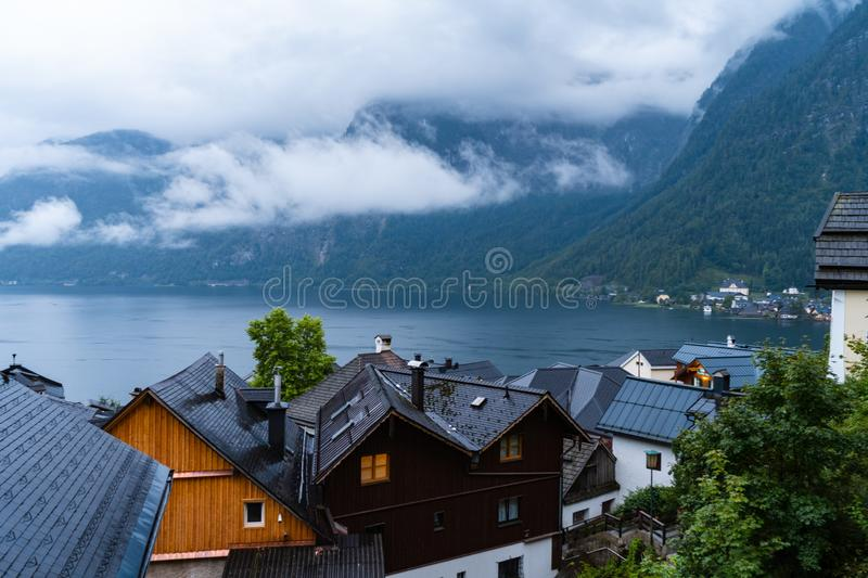 Cloudy blue hour in Hallstatt that is located in Austria. Perfect travel European travel destination for tourism from all over the stock photos