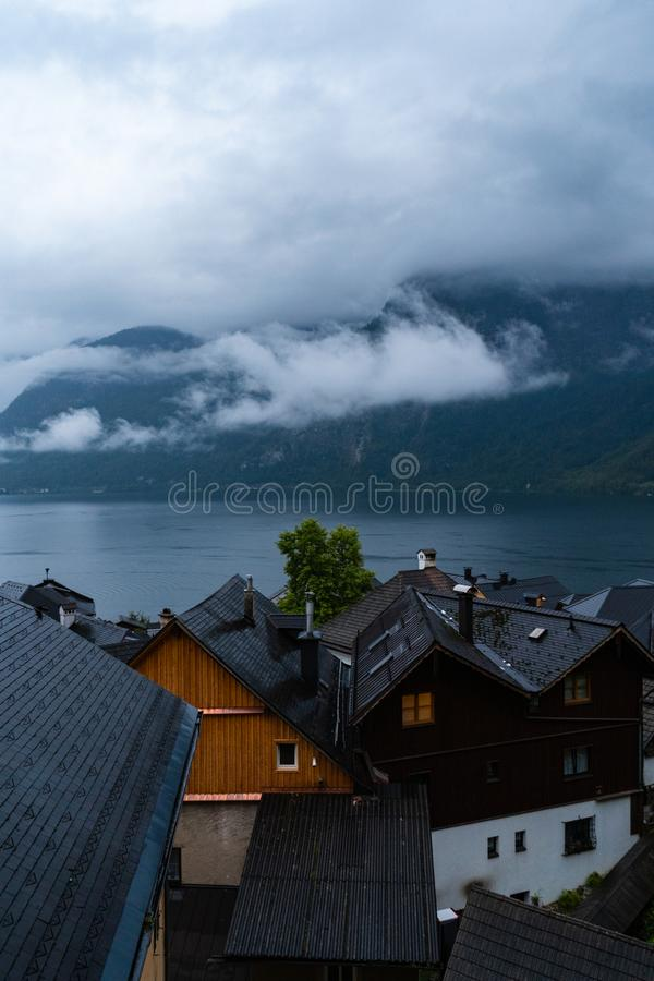Cloudy blue hour in Hallstatt that is located in Austria. Perfect travel European travel destination for tourism from all over the royalty free stock photo