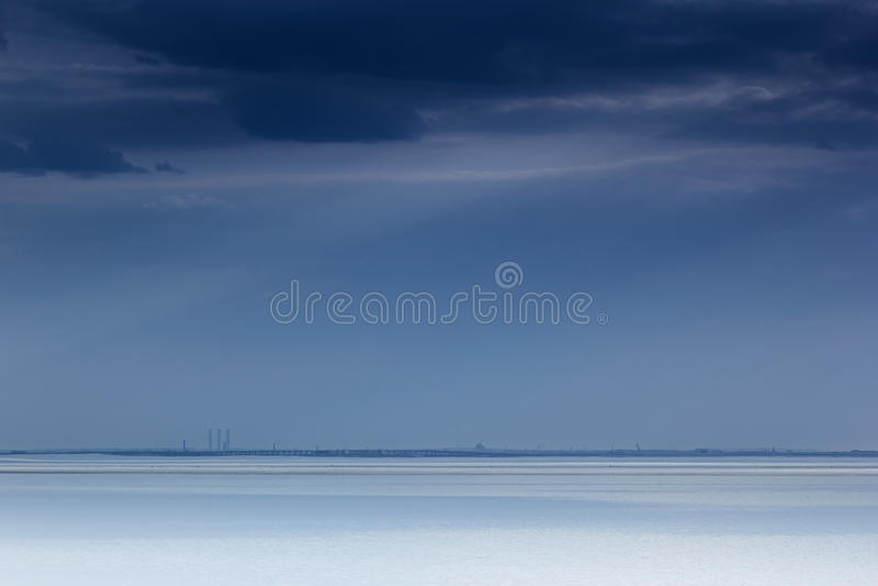 Cloudy blue minimalist seascape. Deserted space. Horizon line. Background stock photos