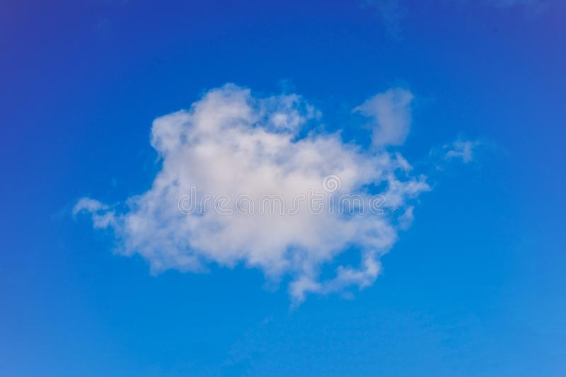 Puffy cloudy blue sky background. Cloudy blue sky taken on a summers day suitable for backgrounds royalty free stock images
