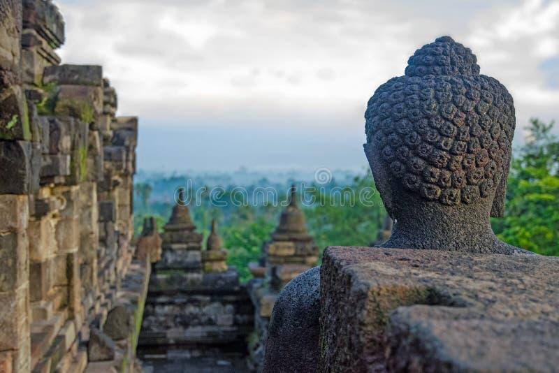 Cloudy Borobudur. Meeting sunrise buddha in Borobudur royalty free stock image