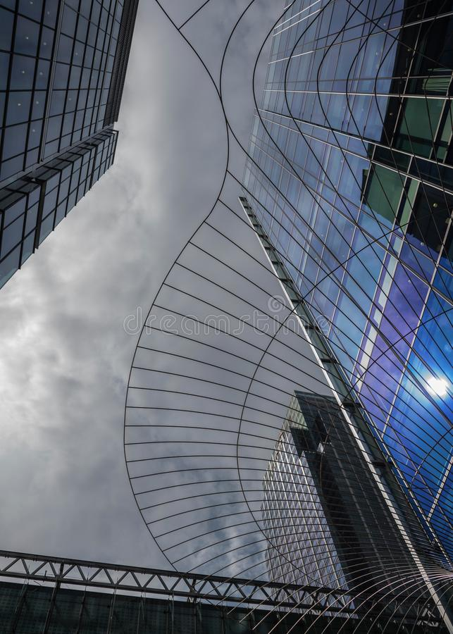 Cloudy and bright sky with modern buildings in Canary Wharf stock photos