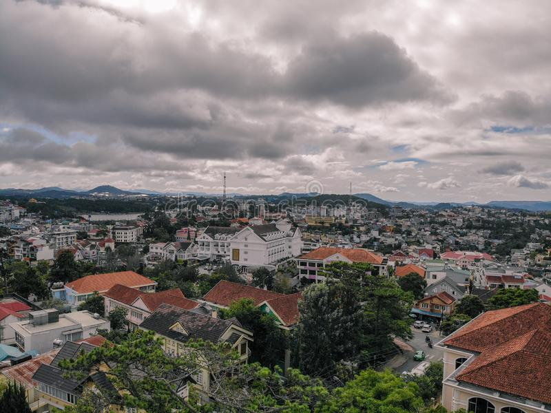 Cloudy Dalat city from drone royalty free stock image