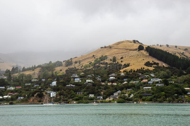 cloudy day at Akaroa harbour, New Zealand royalty free stock photo
