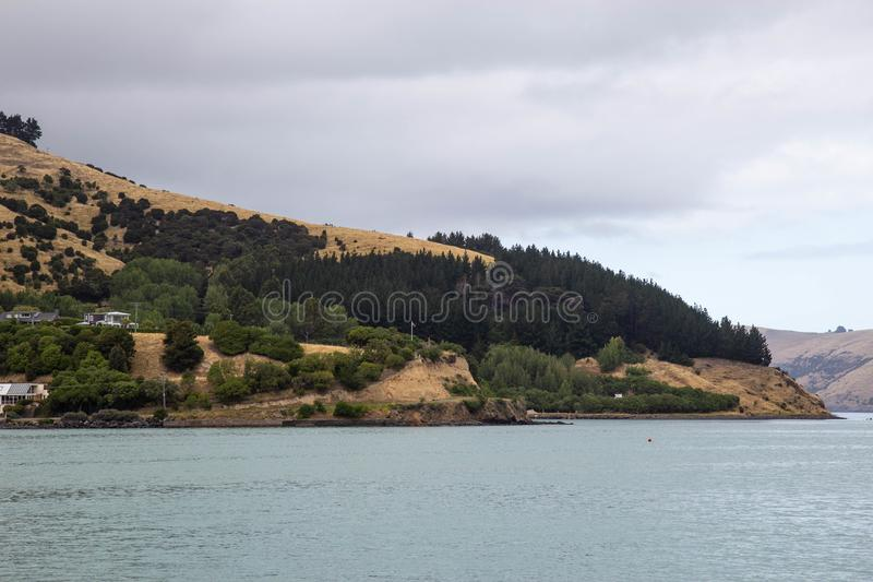 cloudy day at Akaroa harbour, New Zealand royalty free stock photography