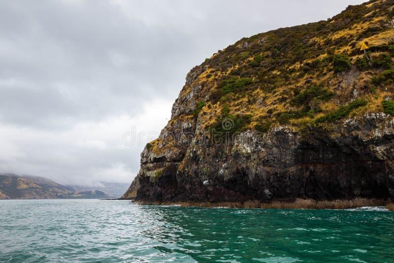 cloudy day at Akaroa harbour, New Zealand royalty free stock photos