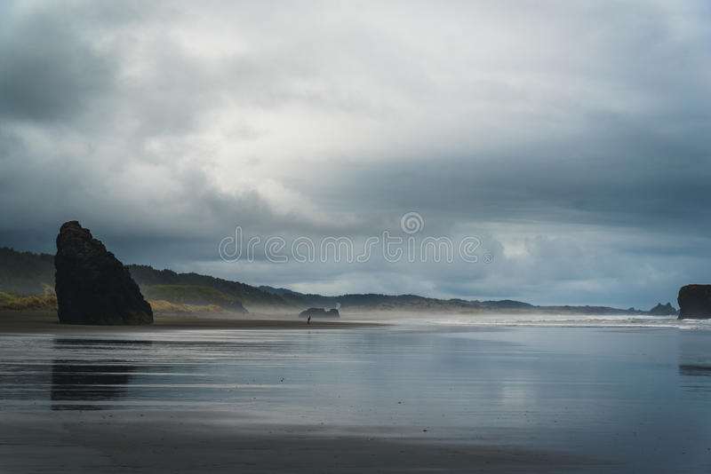 A cloudy day at the beach. royalty free stock images