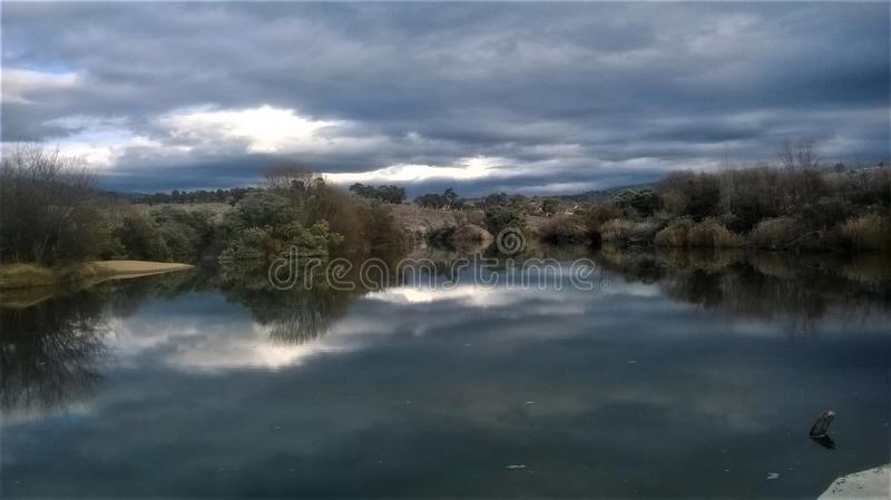 A Cloudy Day Lake Reflection stock photography