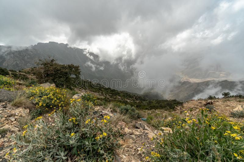 Cloudy view from one of the highest peaks in Saudi Arabia: Jebel Sawda. At a cloudy day like it is one in the Picture a visit to Jebel Sawda becomes even more stock image