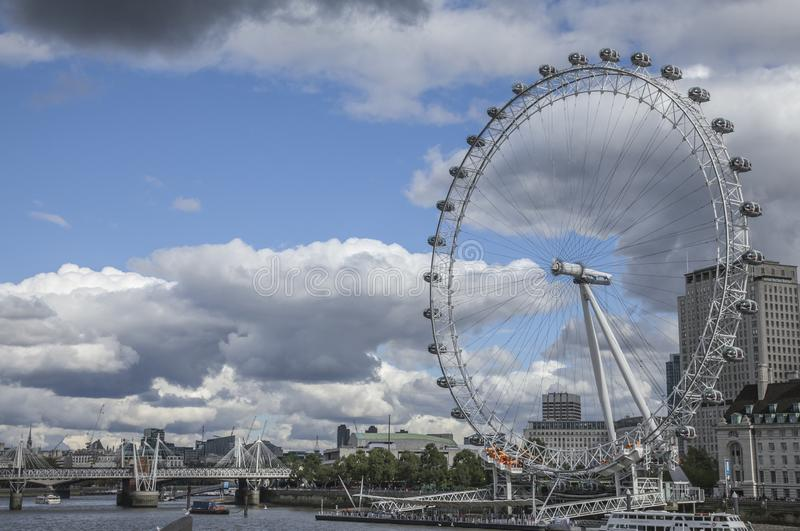 Cloudy day in London - the London Eye. stock images