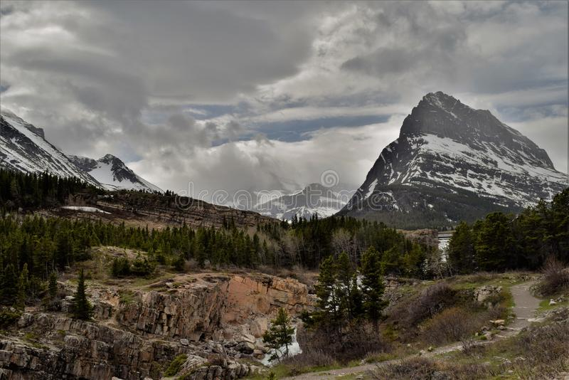 Cloudy day in Many Glaciers Park stock photos