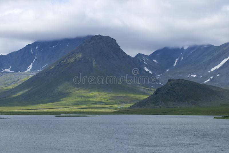 A cloudy day in the mountains of the Polar Urals. Yamal, Russia. A cloudy day in the mountains of the Polar Urals. Yamal. Russia royalty free stock photography