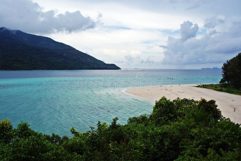 Cloudy day in paradise island stock photography