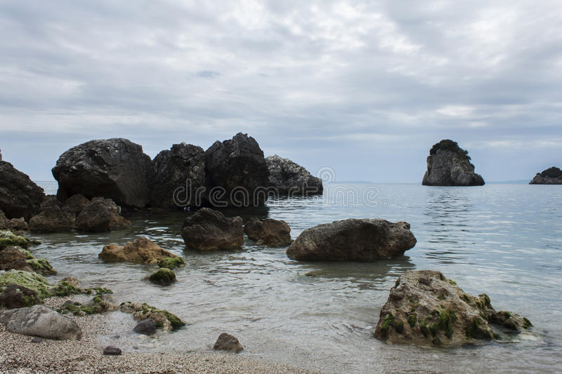 Cloudy day on Piso Krioneri Beach Parga Greece royalty free stock image