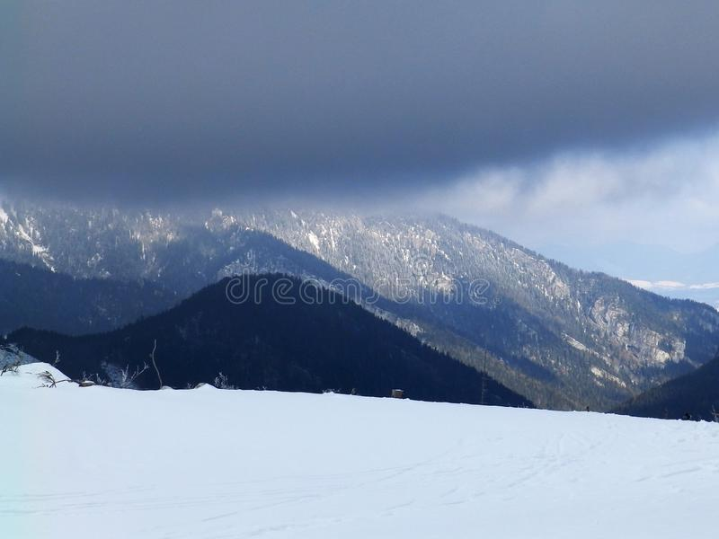 Cloudy day, snowy mountain peaks, cold winter day, Tatra Mountains, royalty free stock photos