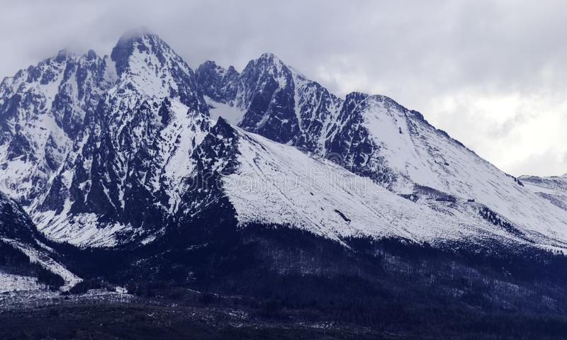 Cloudy day, snowy mountain peaks, cold winter day, Tatra Mountains, royalty free stock photography