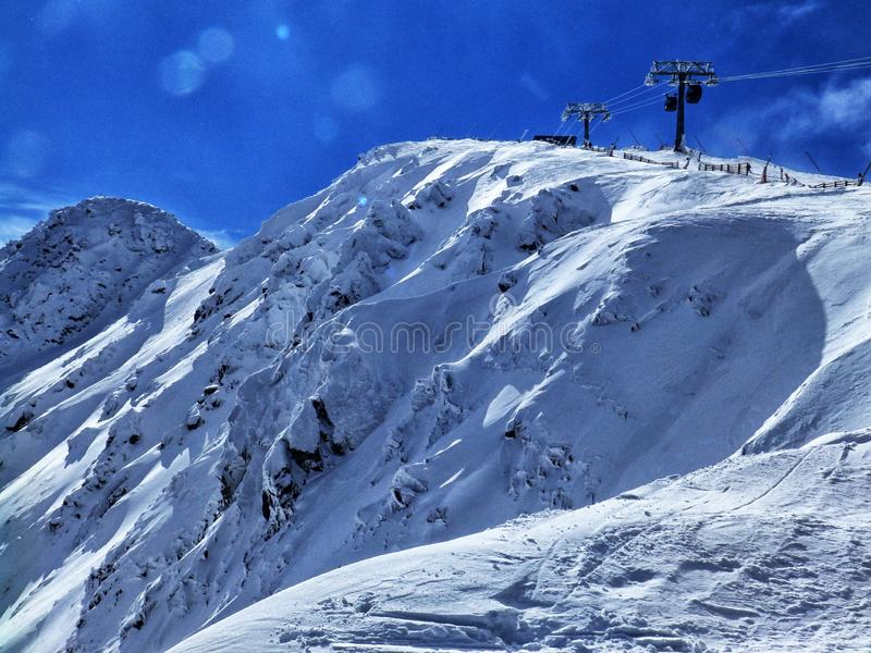 Cloudy day, snowy mountain peaks, cold winter day, Tatra Mountains, royalty free stock photo