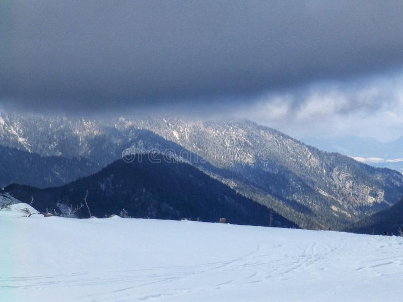 Cloudy day, snowy mountain peaks, cold winter day, Tatra Mountains, royalty free stock images