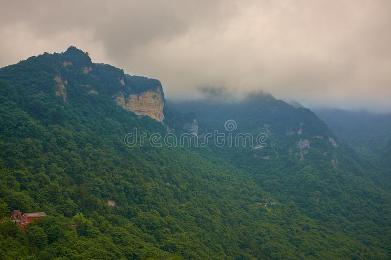 Cloudy day in wudang mountains and ancient building on a hill royalty free stock images