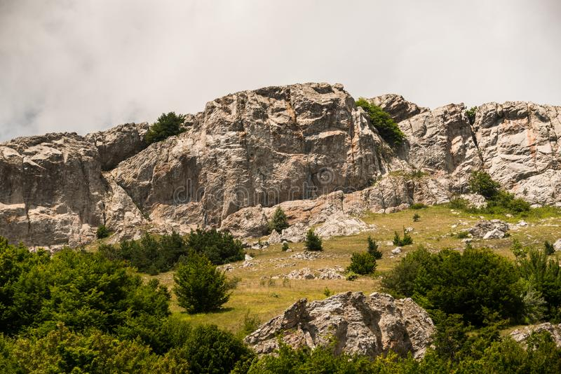 Gray sky over rough rock and valley royalty free stock photography