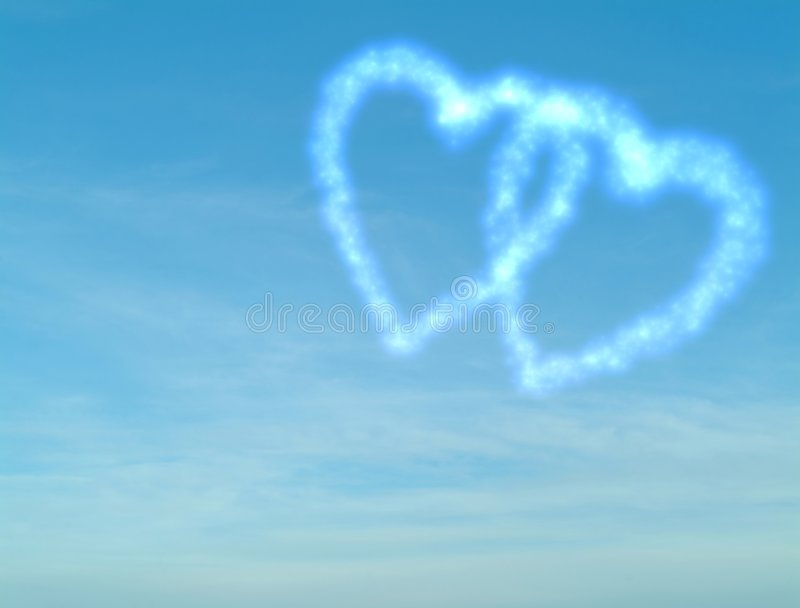 Cloudy heart on blue sky royalty free stock photography