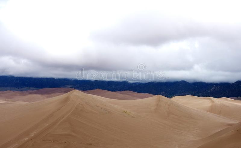 Cloudy High Contrast peaks of Sand Dunes stock photo