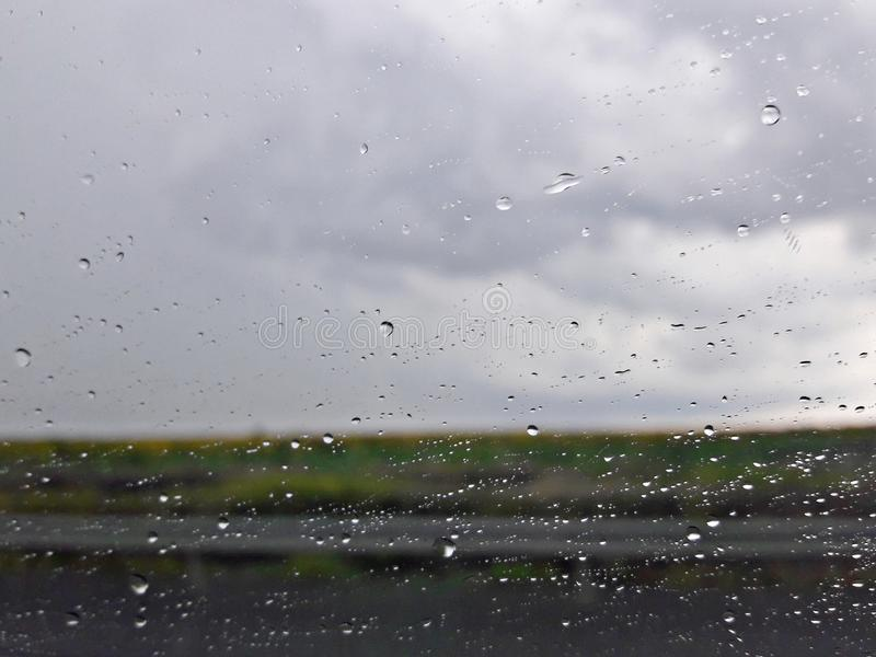 Water droplets on the car window stock photos