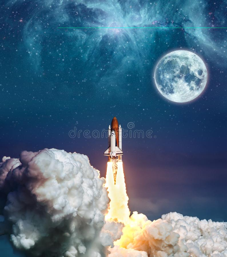 Cloudy launch of rocket Space Shuttle into colorful starry outer space and the full moon. `The elements of this image royalty free stock image