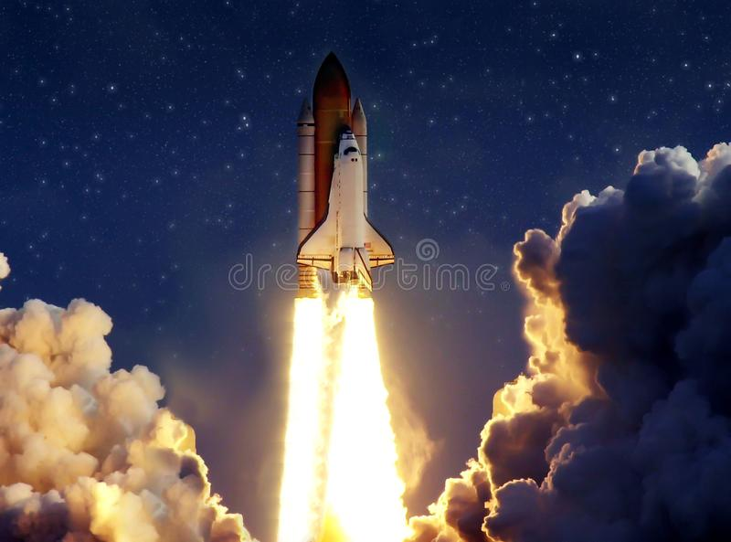Cloudy launch of rocket into starry outer space. royalty free stock photography