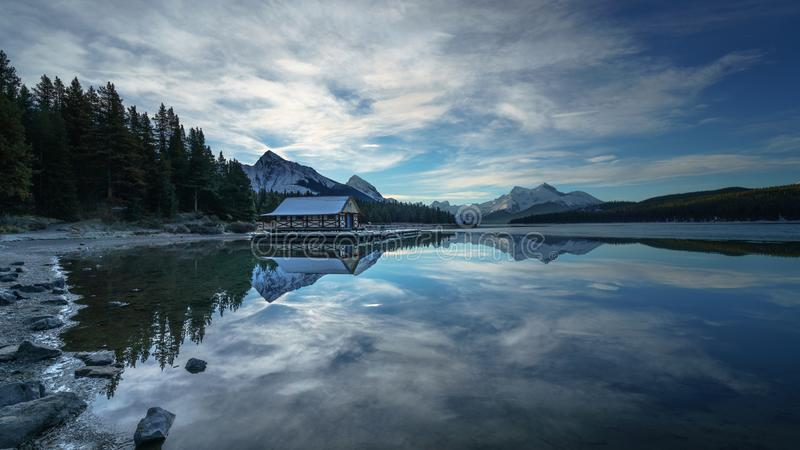 Cloudy morning in Maligne Lake, Jasper National Park. Alberta Canada. Clouds in Maligne Lake with boathouse, jasper Canada royalty free stock photo