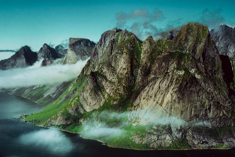 Cloudy mountaintops of fjords royalty free stock photos