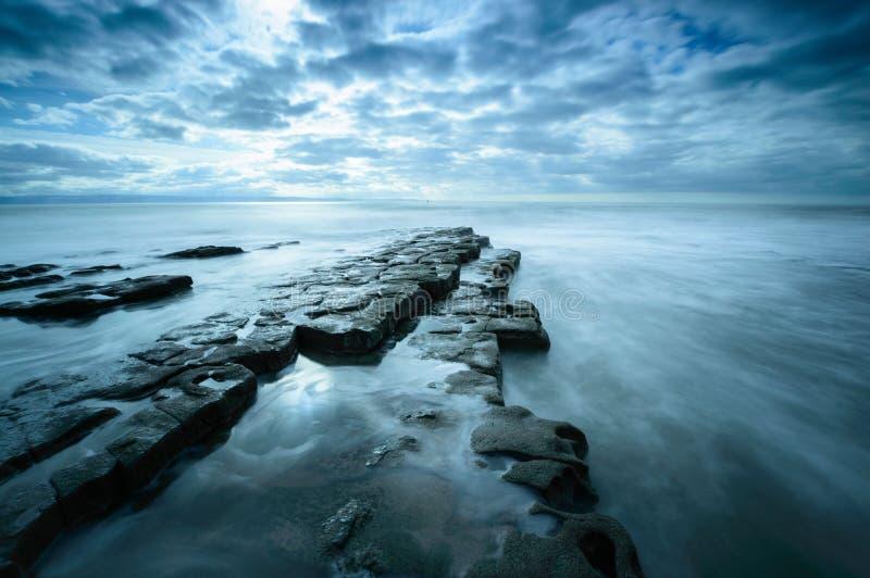 Cloudy Nash Point. A protruding rock shelf at Nash Point, on the Glamorgan Coast, Wales stock photos